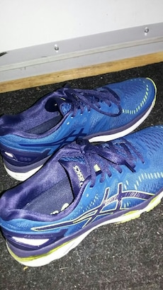 pair of blue Asics running shoes