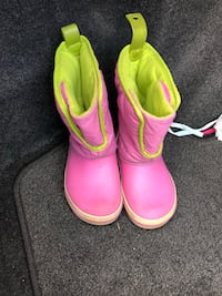 pair of pink crocs boots
