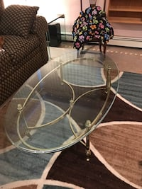 stainless steel base oval clear glass top table Brookhaven, 11776