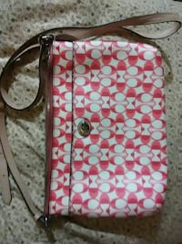 monogrammed white and red Coach crossbody bag