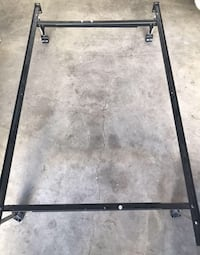 Queen bed frame metal on wheels, adjusts, like new
