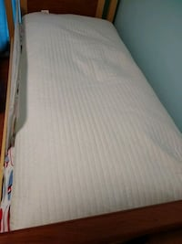 white and gray bed mattress 24 km