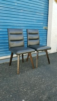 2 gray dining chairs with brown wood legs.  Phoenix, 85027
