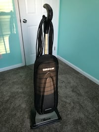 black and gray upright vacuum cleaner 40 km