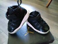 pair of black Air Jordan 11's Salt Lake City, 84123