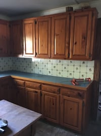 Beautiful, solid knotty pine cabinets and Robin blue Formica counter top.  Waldorf
