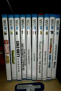 Black wii u with 10 games 2 wii remotes and a pro  Fayetteville, 17222