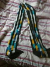 black, white, yellow, and teal textile