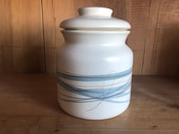 white and blue ceramic jar with lid