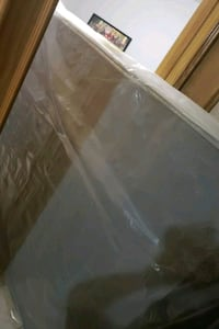 Queen box spring still in plastic