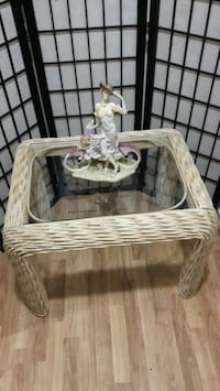Rattan table with glass top.