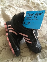 Pair of black-and-white adidas cleats Tracy, 95376