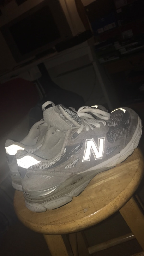 pair of gray New Balance running shoes