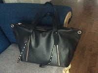 Black leather handbag clean dress inside and out Laval, H7X 3M8