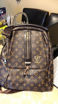 brown monogrammed Louis Vuitton leather backpack Calgary, T2A 0C4