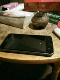 black android smartphone with charger Spokane, 99201