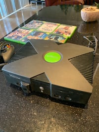 Xbox console with controller and games