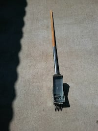gray and brown wooden handle hand tool