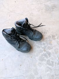 pair of black leather work boots Tucson, 85712