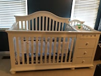 Quality white wooden crib with changing station