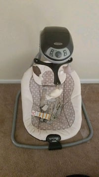 baby's gray and white Graco cradle and swing 29 mi
