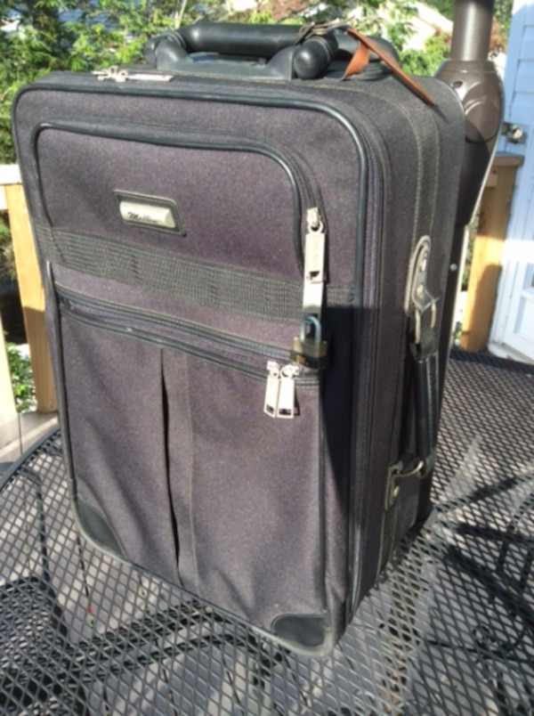 8bc3a4eaacd0 Used overhead luggage by McLLIN excellent condition  4 zippered  compartments  handle rises 17