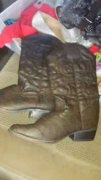 pair of brown deep-scallop round-toe roper-heeled mid-calf cowboy boots
