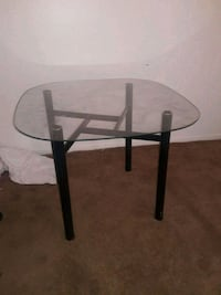 round glass top table with black metal base 1129 mi