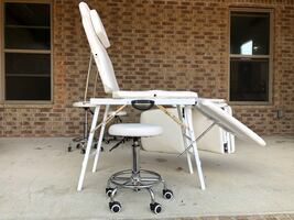 Adjustable massage tables with chair