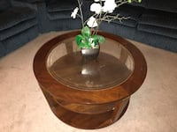 round brown wooden framed glass top coffee table North Las Vegas, 89032