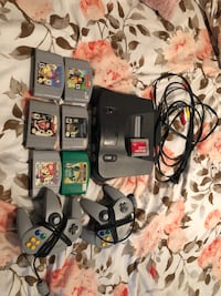 black Nintendo 64 console with controllers and game cartridges Bartow, 33830