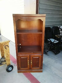 brown wooden shelf with drawer