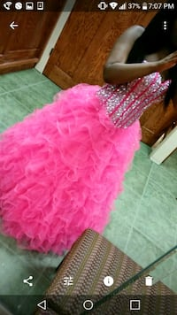 Prom dress. Bold pink with crystals on top.