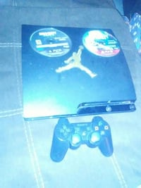 Black sony playstation 3 with two games