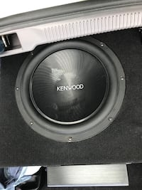 Black Kenwood sub-woofer in box with 1100W amp