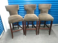 four brown wooden framed beige padded chairs Hyattsville, 20784