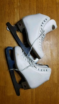pair of white-and-black ice skates Brooklyn, 11223