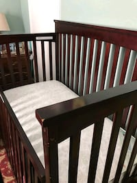 baby's brown wooden crib mattress and changing  Manassas, 20109
