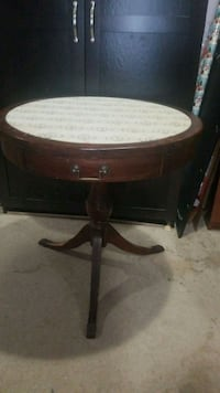 brown wooden framed white marble top table