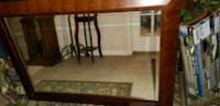 Large old wood mirror with beveled mirror
