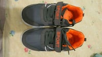 pair of black-and-orange Nike basketball shoes