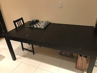 Large sturdy black dinner table