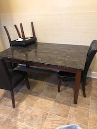Black granite dining room table leather chairs included Baltimore, 21207