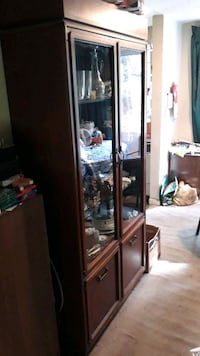 brown wooden framed glass display cabinet Falls Church, 22046