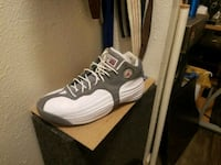 unpaired white and gray Nike basketball shoe 1176 mi