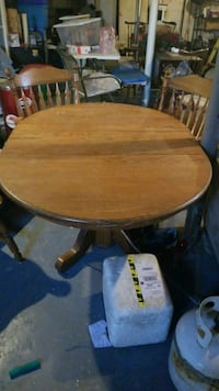 round brown wooden table with four chairs dining s Lanham, 20706