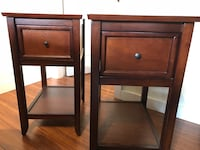 two brown wooden 1-drawer side tables