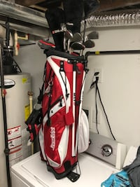 Golf clubs and Red and black golf bag. The bag is regular sized. It just looks small in the picture Cresskill, 07626
