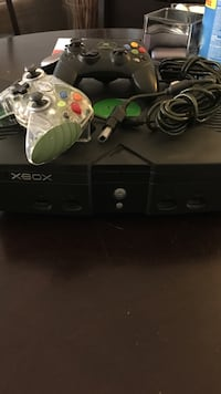 black Xbox Original console with controllers