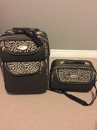 two black-and-brown floral luggage bags Lincoln, L0R